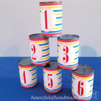 Six cans turned into a bean bag toss carnival game for a birthday party.