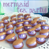 Clam cookies on a tray with text overlay: Mermaid Tea Party.