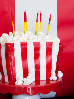 DIY Popcorn bucket cake with marshmallow popcorn and fondant outside.