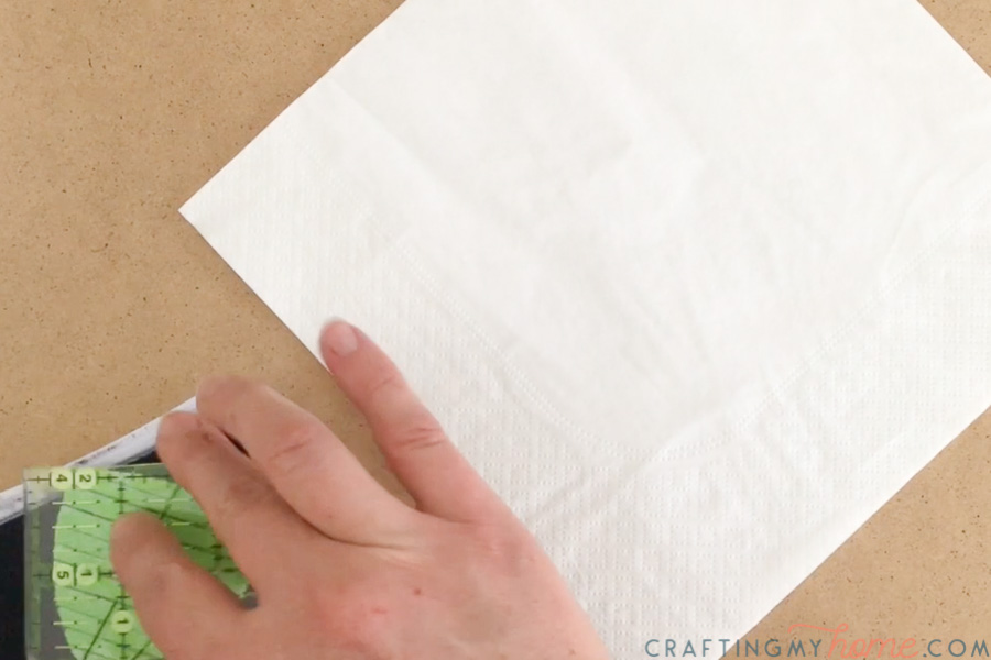 Placing homemade foam stamp on stamp pad next to napkin.