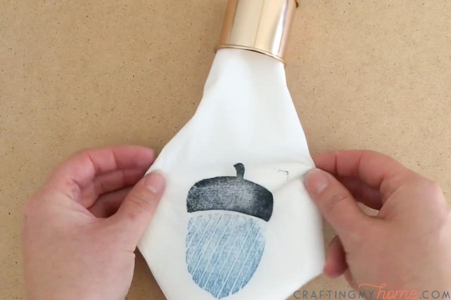 Straightening the homemade decorative napkin in a copper napkin ring.