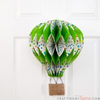 Hot air balloon decor hanging on a white 6 panel door.