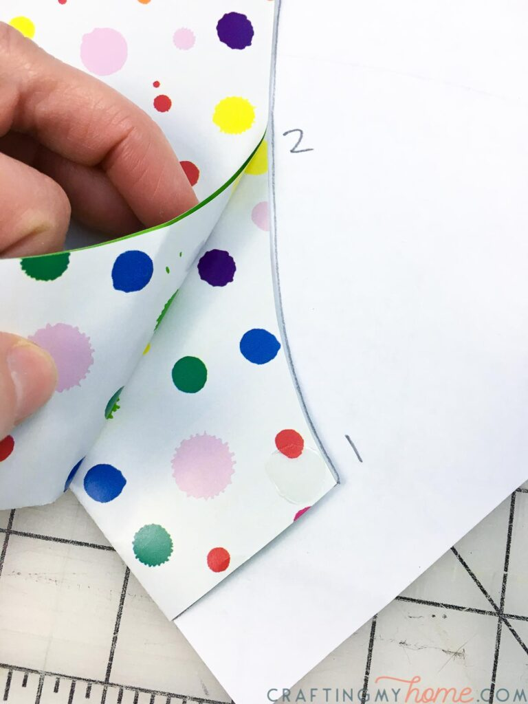 Securing the pieces together with glue dots next to the numbers.
