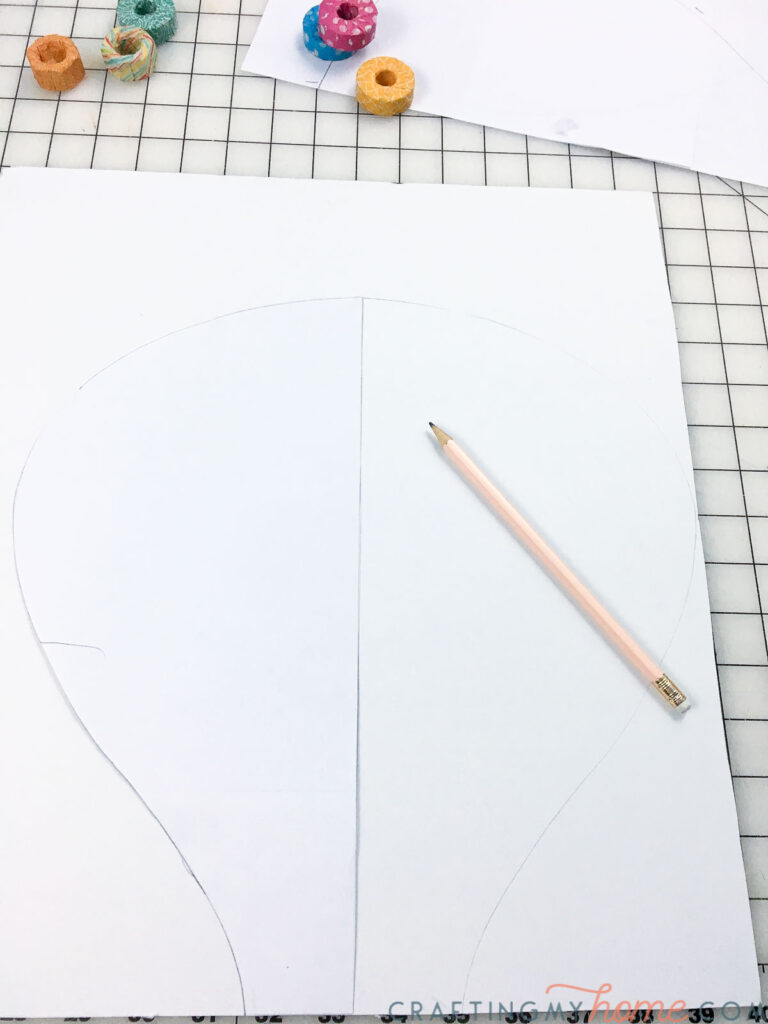 Tracing the template on the foam core board.