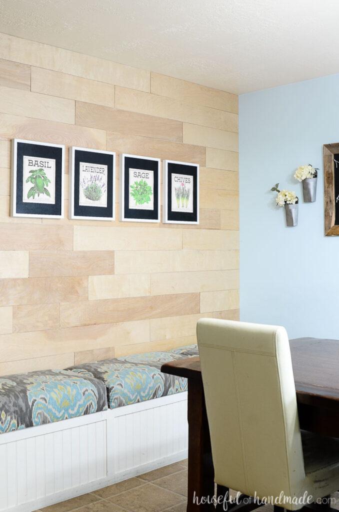 vintage inspired herb prints hanging on wood wall