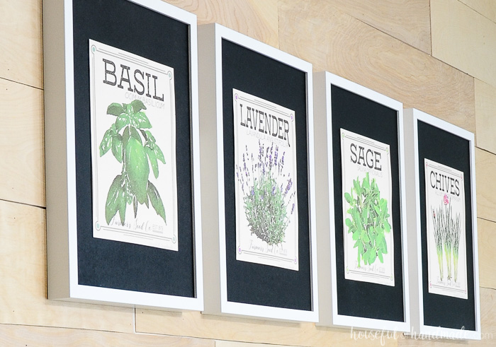 close up of vintage inspired herb prints hanging on wall