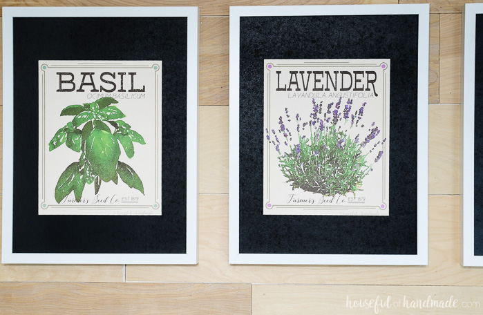 two herb prints on wood wall