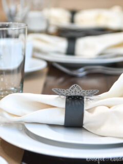 Detailed view of the snowflake paper napkin rings on the papercraft winter tablescape.