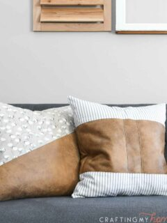 DIY farmhouse pillows with faux leather and canvas colorblocking on a couch.