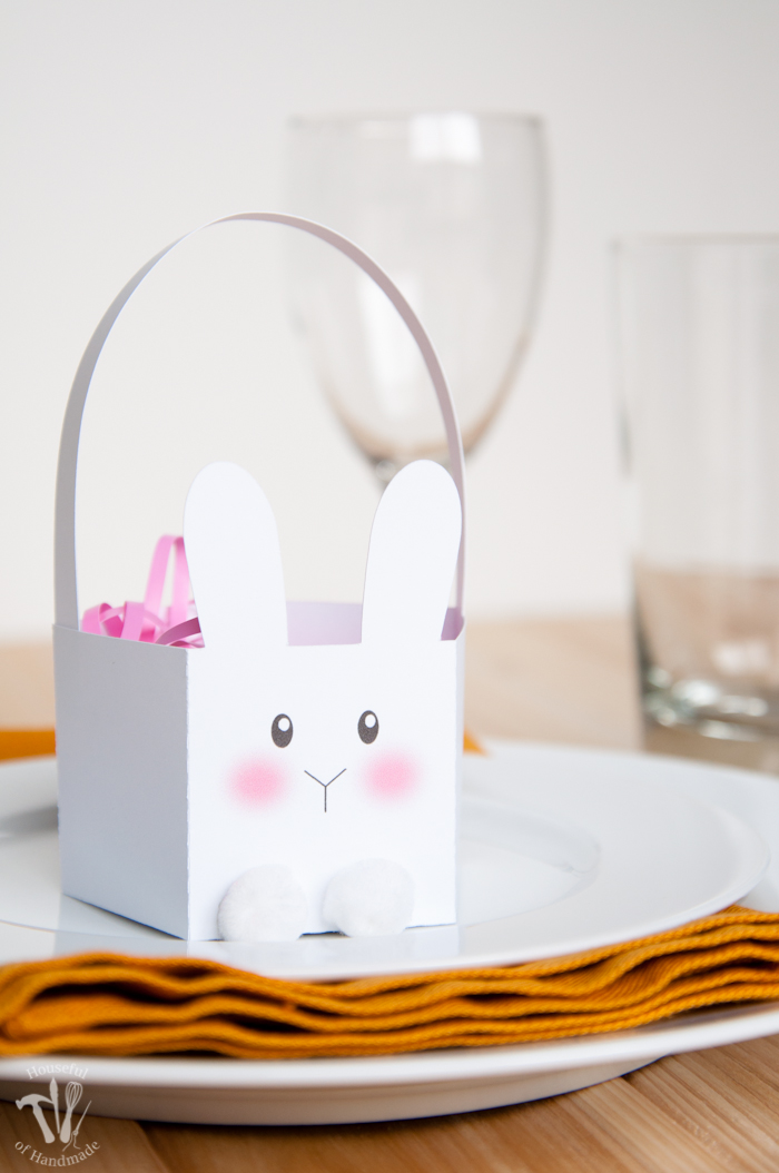 White bunny Easter basket on a table setting.