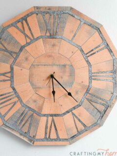 Pallet wood clock made out of paper hanging on the wall.