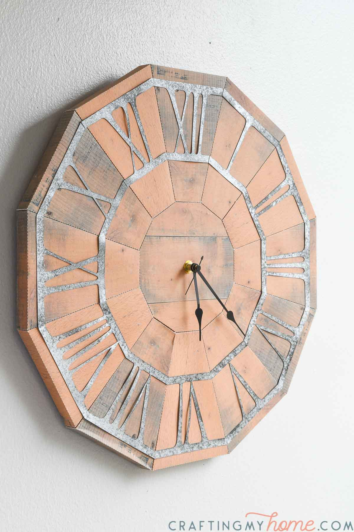 Angled photo of the pallet wood clock with working clock hands.
