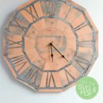 DIY pallet wood clock made out of paper with text overlay.