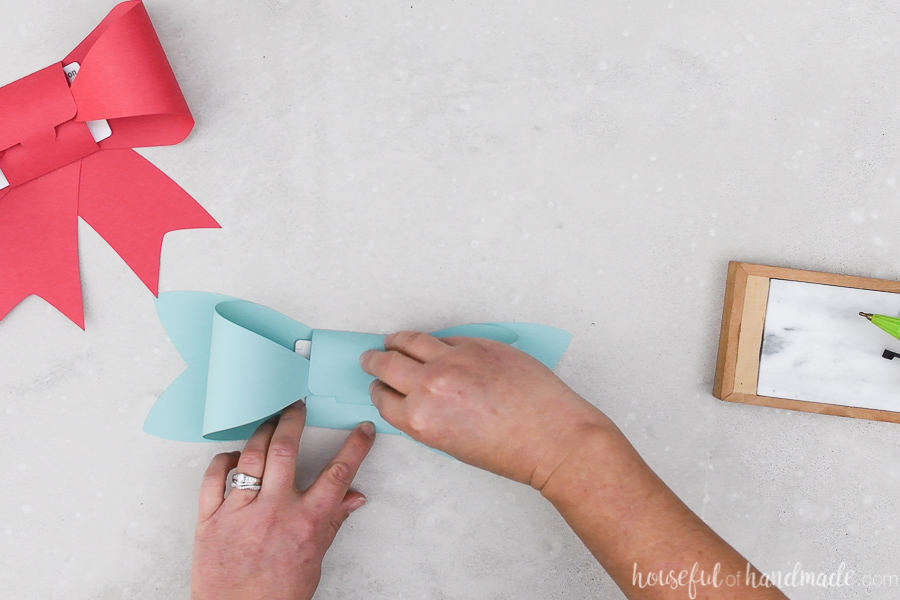 Folding the second gift card bow around a Starbucks gift card.