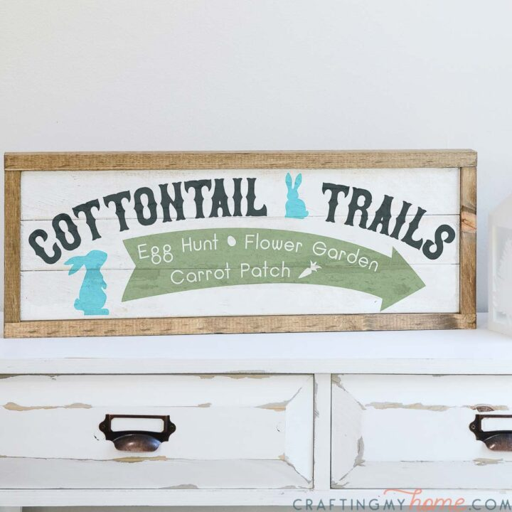 Close up of the Cottontail Trails Easter sign painted with sage and turquoise colors.