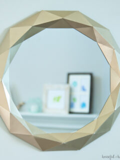 Gold painted Anthropogie knock off mirror made out of paper.