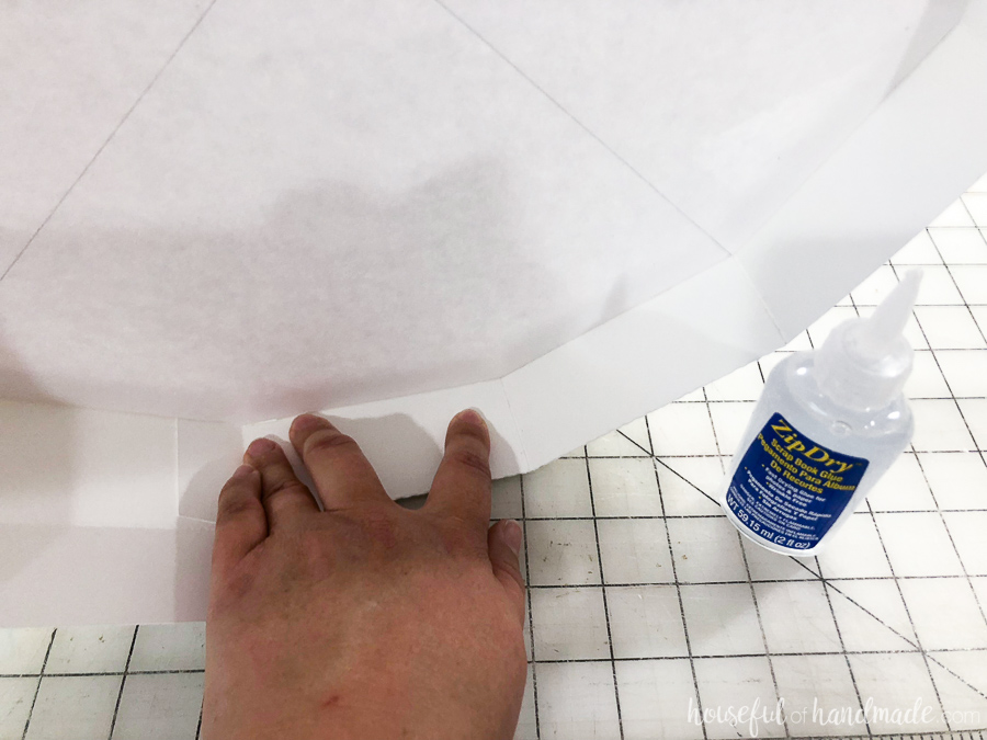 adding glue to the flaps of wall planter to secure