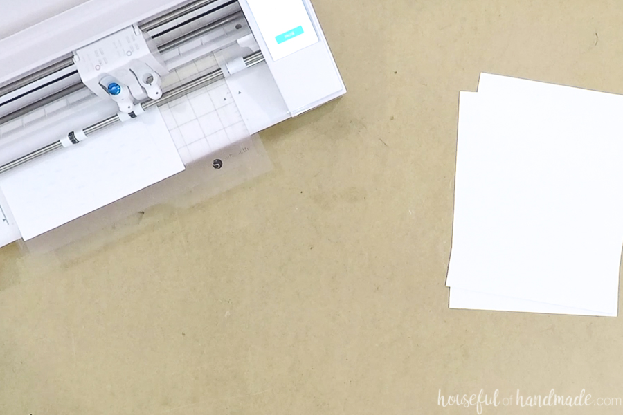Flower pot template being cut out of cardstock with the Silhouette Cameo 3.