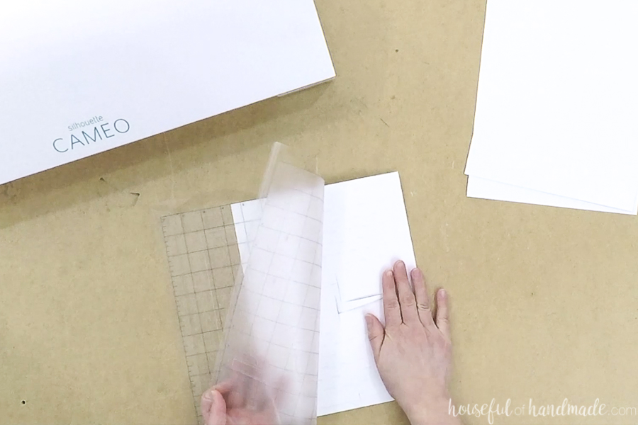 Removing the cutting mat for the Silhouette from the cut out pieces.