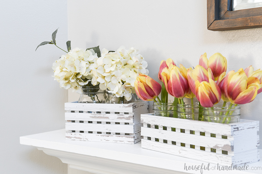 White lattice trough boxes with flowers.