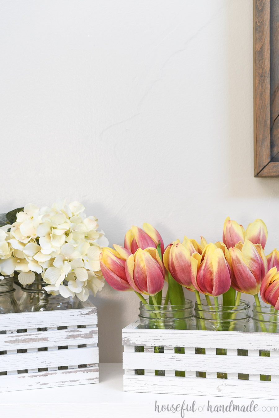Decorative faux wood trough boxes with flowers in them for spring.