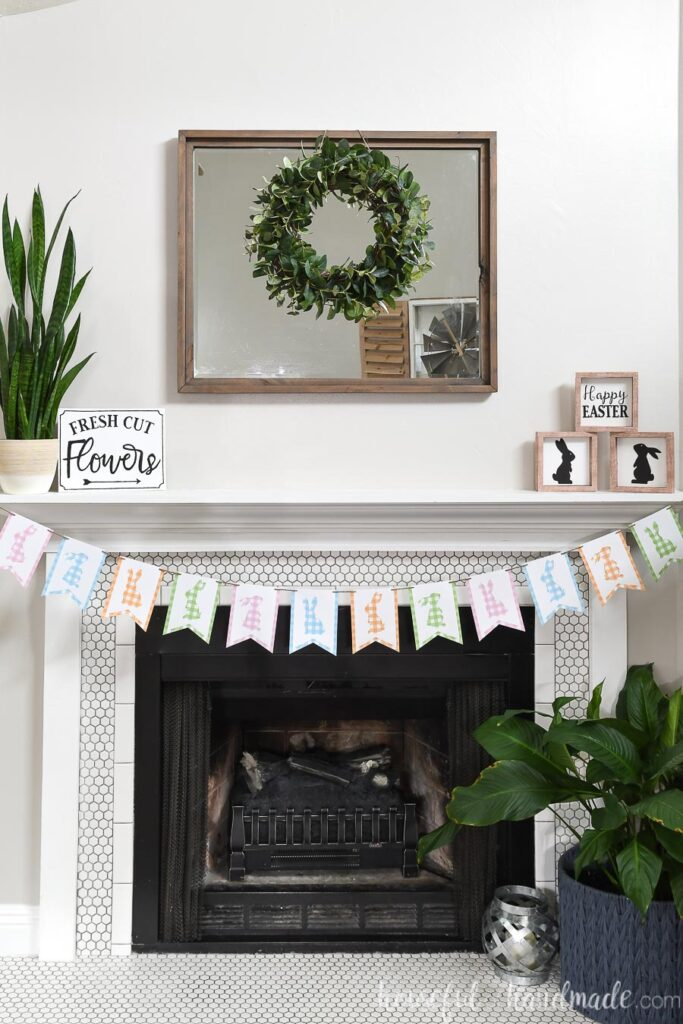 White tiled fireplace decorated for spring with paper crafts.