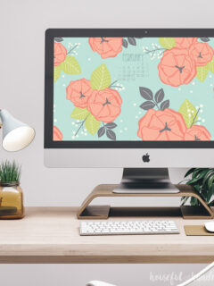 Free digital backgrounds for February on a desktop computer on a desk.