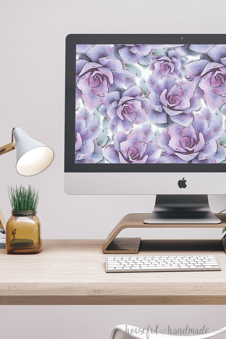 iMac computer on a desk with digital wallpaper for January on the background.