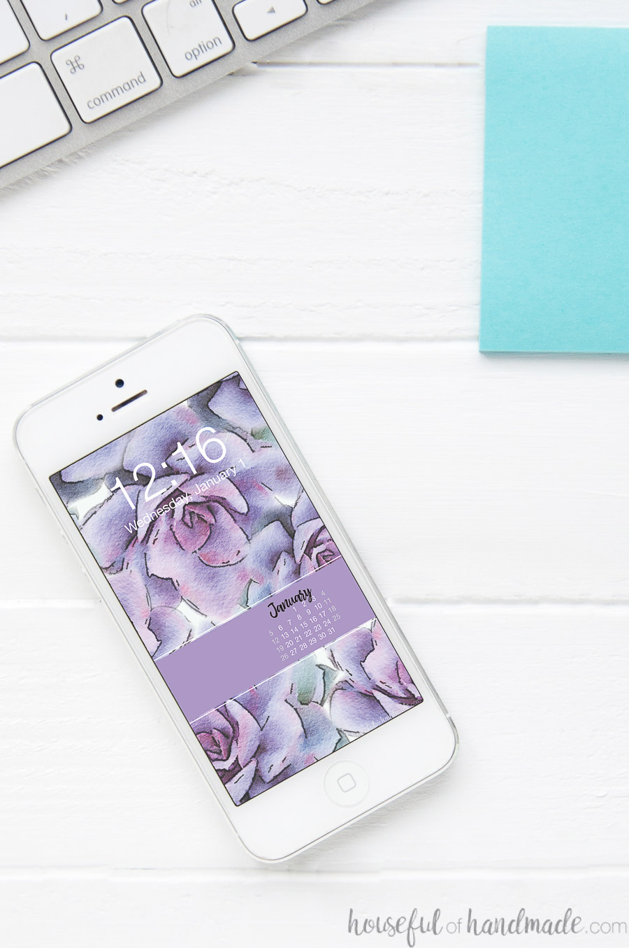 iPhone with purple watercolor succulent print on the background as digital wallpaper with a January calendar on it.