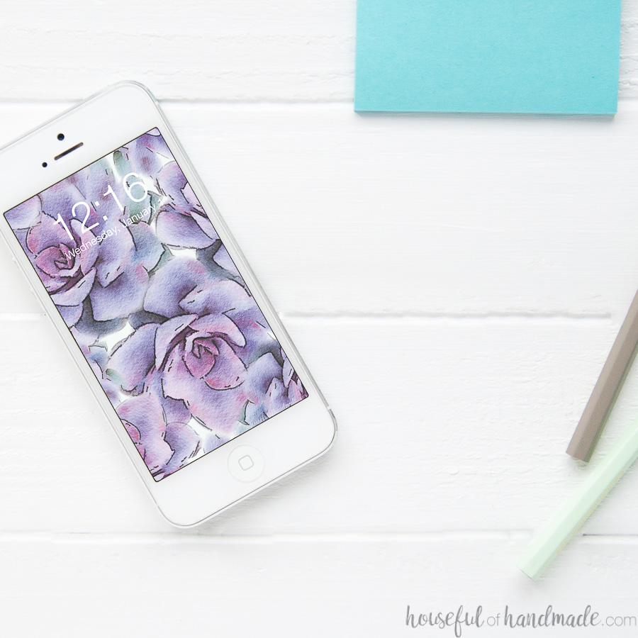 Cell phone with a purple succulent digital wallpaper on the home screen.