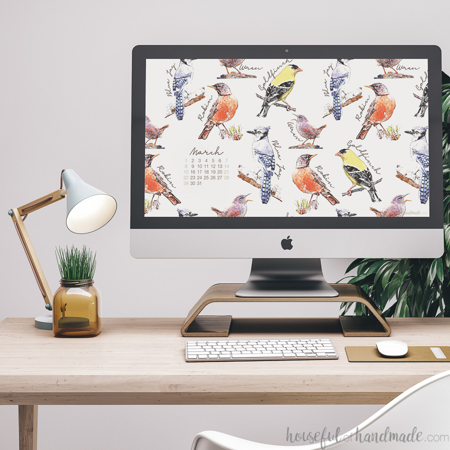iMac computer with a spring digital wallpaper on the desktop.