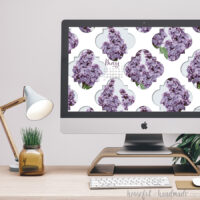 Square photo of an iMac computer with the free digital wallpaper for May on the screen.