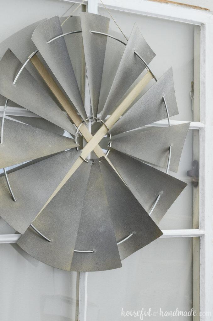 close up of decorative windmill on window
