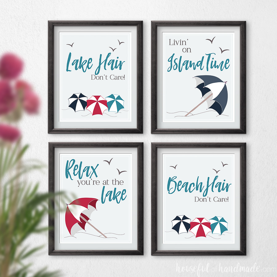 Four lake and beach art prints with beach umbrellas and text on a wall.