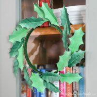 paper holly wreath on door