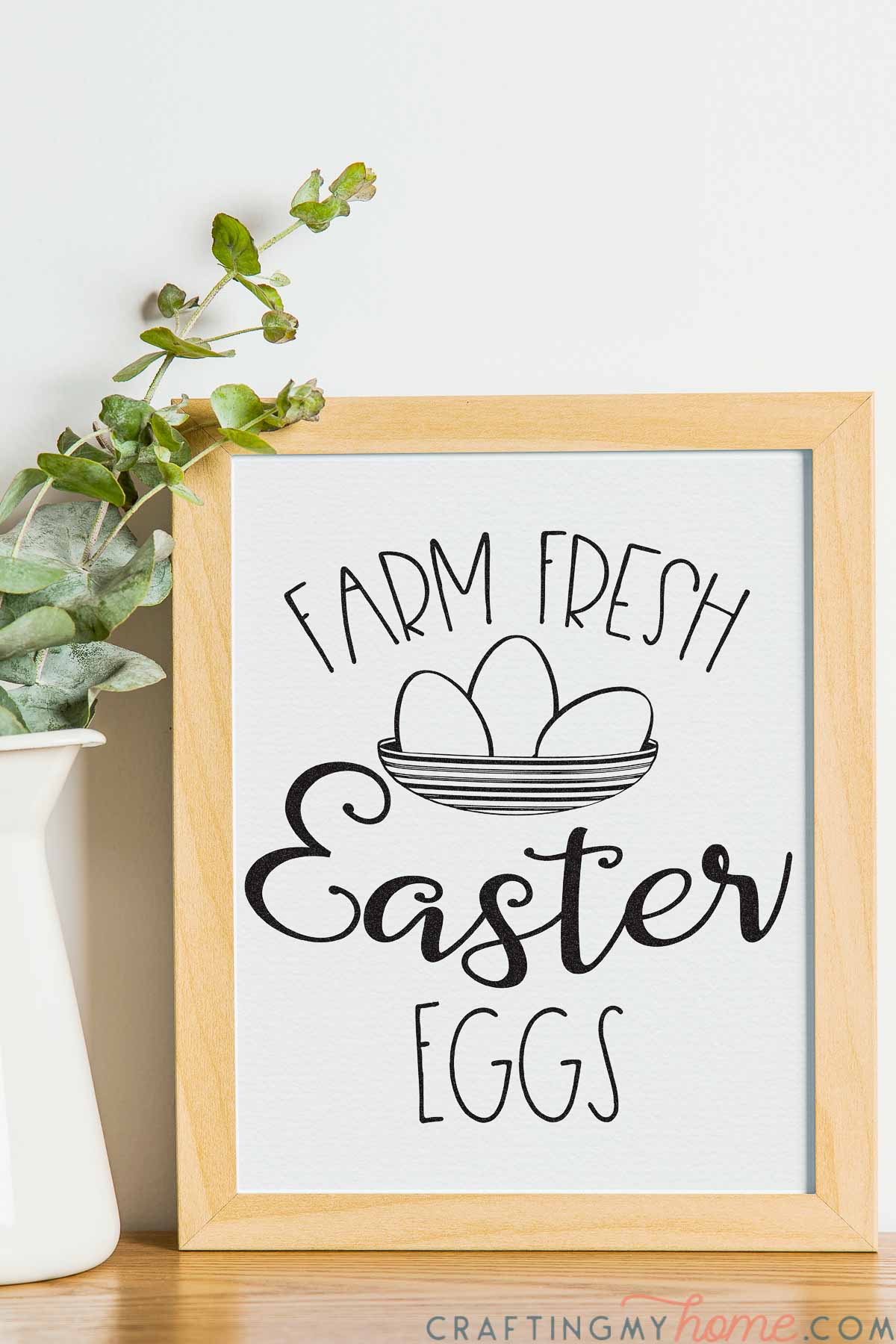 """Simple easter sign that says """"Farm Fresh Easter Eggs"""" with a sketch  of a bowl filled with 3 eggs in a picture frame."""