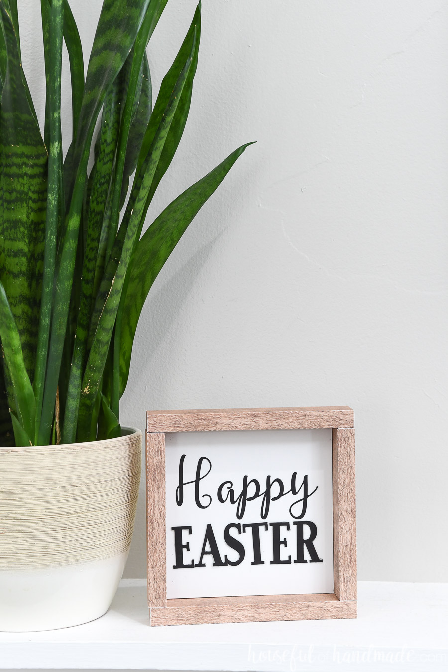 """Simple Easter sign with words """"Happy Easter"""" on the front."""