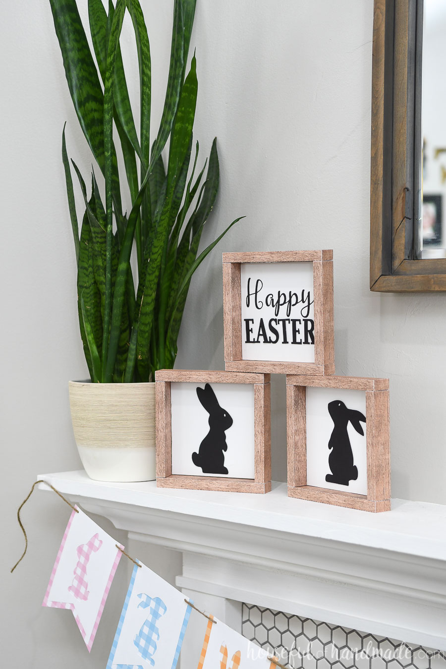Fireplace mantel decorate with Easter signs for spring.
