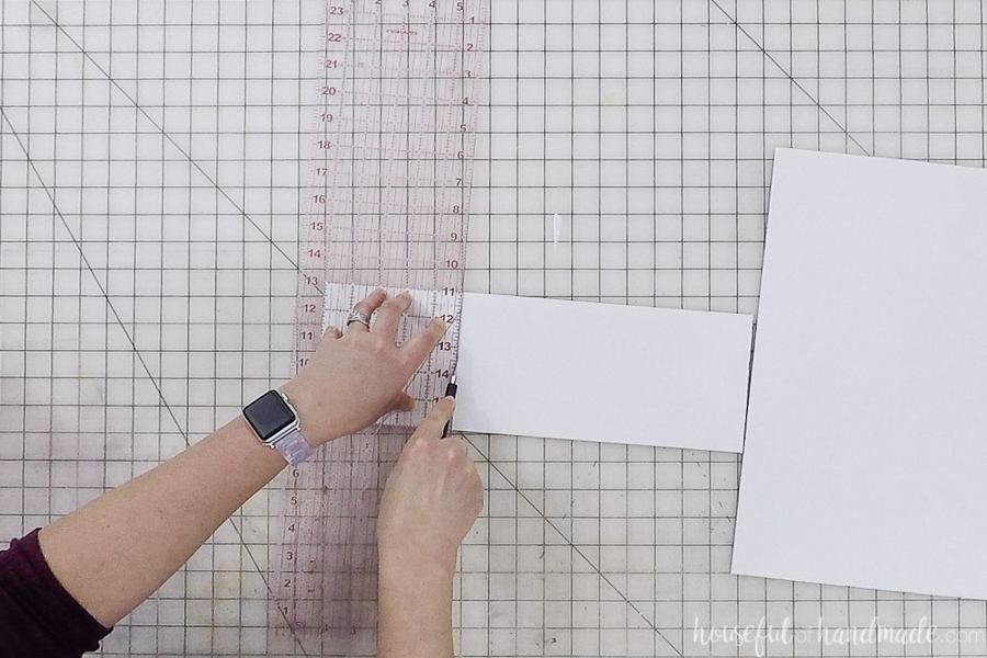 Cutting foam board with a quilting ruler and x-acto knife.