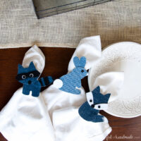 Three woodland critter spring napkin rings on a table.