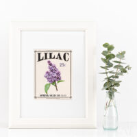 White frame with white mat and printable art that looks like a vintage seed packet for Lilac flowers.