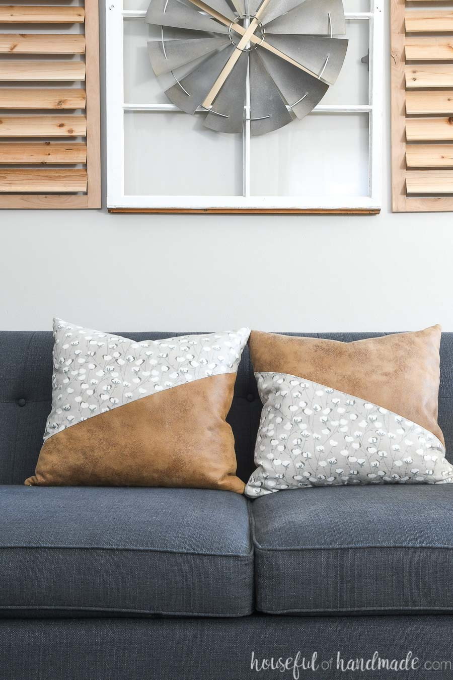 Two mirrored diagonal leather pillow covers on a sofa.