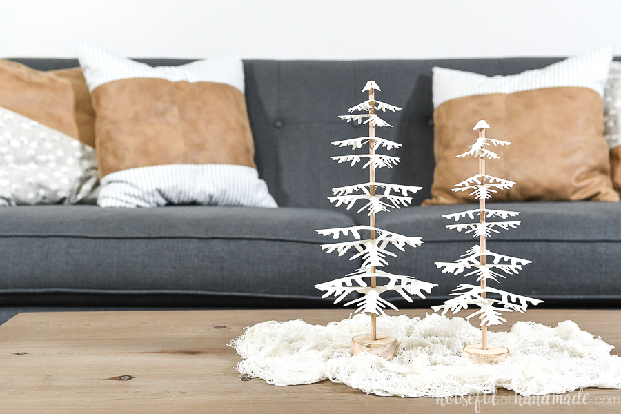 set of 2 decorative paper christmas trees on coffee table