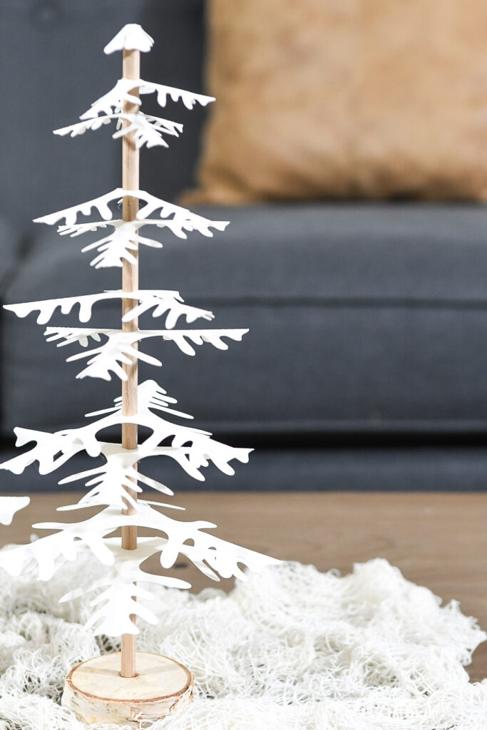 single paper christmas trees set of 2 on coffee table in front of couch