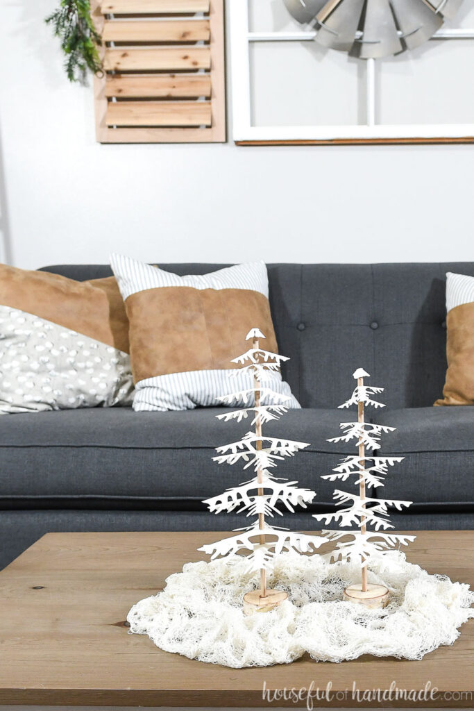 set of 2 completed paper christmas trees on table in front of couch
