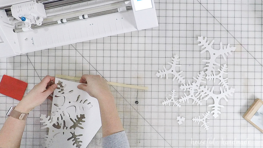 assembling cut out paper christmas trees