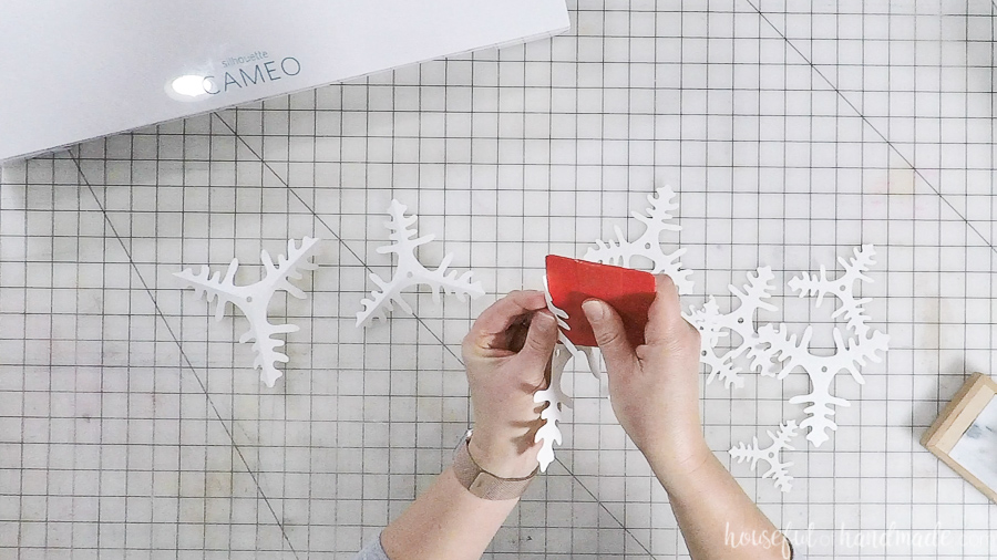 assembling cut out paper christmas trees with straight edge