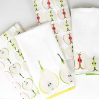 Four DIY tea towels made from custom printed fabric.