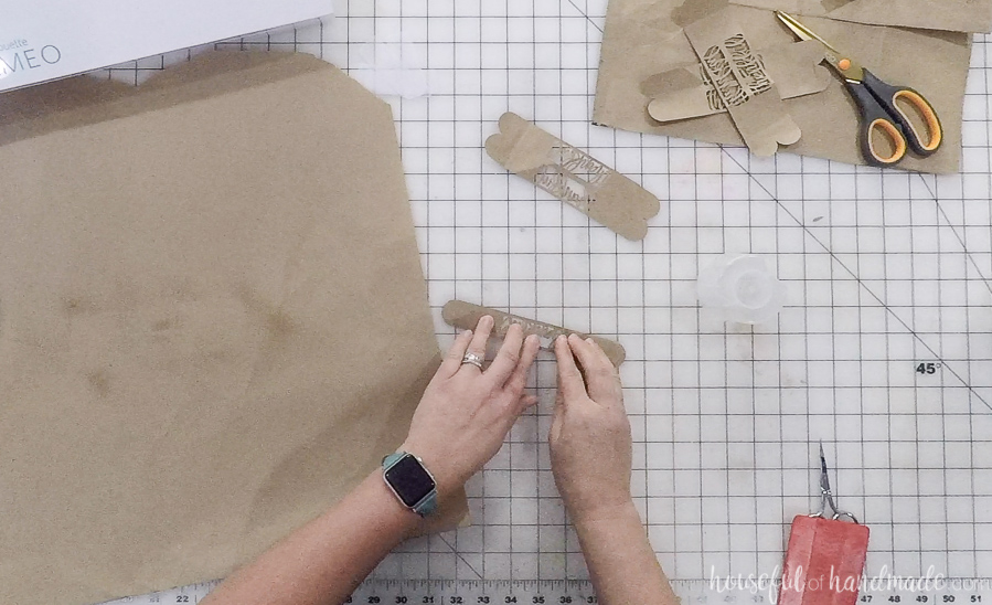 securing cut out paper napkin rings with adhesive