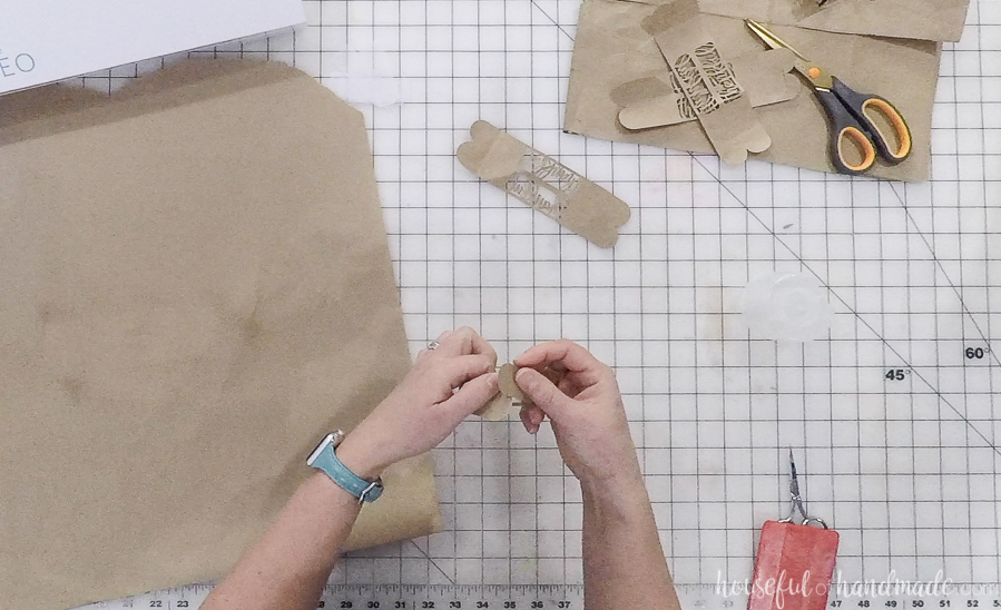folding cut out paper napkin rings and securing tabs